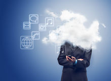 Businessman with phone and the cloud with applications icons Stock Image