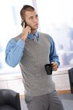 Businessman with phone and coffee Stock Image