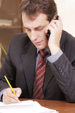 Businessman at phone conversation Stock Photo
