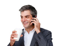 Businessman on phone and drinking a coffee Stock Photos