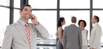 Businessman on the phone in front of business team Royalty Free Stock Photo