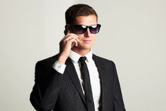 Businessman on the phone. handsome man in suit and sunglasses Royalty Free Stock Photos