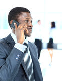 Businessman on the phone in his office Stock Photography