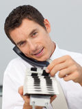 Businessman on phone holding a card holder Royalty Free Stock Photography