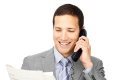 Businessman on phone holding a newspaper Royalty Free Stock Photos