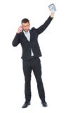 Businessman on the phone holding up calculator Royalty Free Stock Images