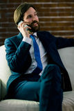 Businessman on the phone. At home in the living room Stock Photography