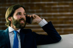 Businessman on the phone. At home in the living room Royalty Free Stock Photo