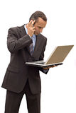 Businessman phone and laptop Stock Images