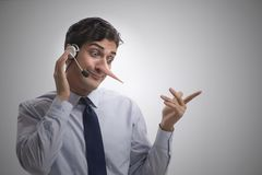 The businessman on the phone lying to his opponent. Businessman on the phone lying to his opponent stock images
