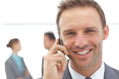 Businessman on the phone during a meeting Royalty Free Stock Photo