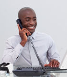 Businessman on phone in the office Stock Photography