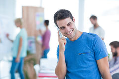 Businessman on the phone in the office Stock Photography