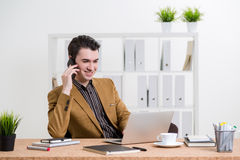 Businessman on phone in office Stock Photos