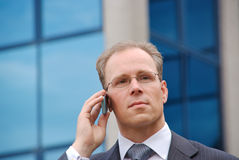 Businessman on the phone outside Stock Photography