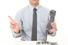 Businessman with a phone. Businessman pointing with his finger royalty free stock photography