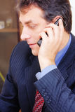 Businessman with phone sideview Royalty Free Stock Photography