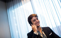 Businessman on the phone. And smiling Royalty Free Stock Photography