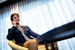 Businessman on the phone. Smiling Royalty Free Stock Photos