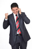 Businessman on Phone Smiling About Good News Royalty Free Stock Photography