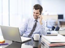 Businessman on phone Stock Photo