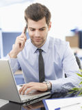 Businessman on phone Stock Image