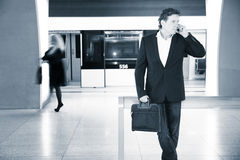 Businessman with phone in the subway Stock Photo