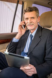 Businessman with phone and tablet Stock Images