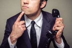 Businessman on the phone is thinking Royalty Free Stock Photo