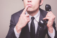 Businessman on the phone is thinking Royalty Free Stock Photography
