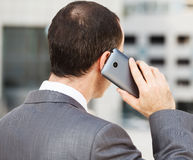 Businessman with phone Royalty Free Stock Image