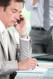 A businessman phoning Royalty Free Stock Images