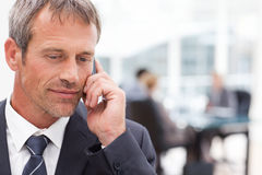 Businessman phoning in his office Stock Images