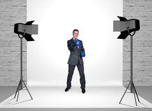 Businessman in photo studio with spotlights Royalty Free Stock Photography
