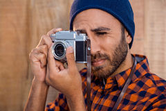 Businessman photographing through camera Stock Photography