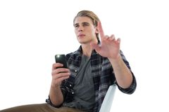 Businessman photographing while using imaginary screen Stock Photo