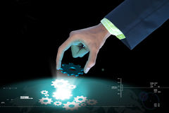 Businessman pick the gear elements Royalty Free Stock Image