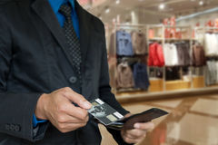 Businessman picking card. Stock Images