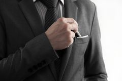 Businessman picking a pen from the pocket. Royalty Free Stock Photography