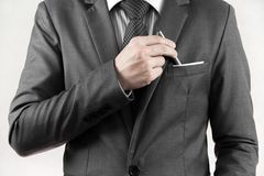 Businessman picking a pen from the pocket. Stock Photo