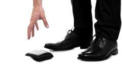 Businessman Picking Up Fallen Wallet Royalty Free Stock Photo