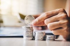 A businessman is picking up his coin.The concept of financial sa royalty free stock photo