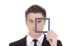 Businessman in picture frame. Royalty Free Stock Photos