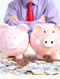 Businessman with a pig bank Royalty Free Stock Images