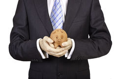 Businessman with a piggy Stock Image