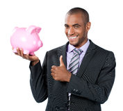 Businessman with piggy bank Stock Images