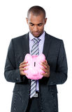 Businessman with piggy bank Royalty Free Stock Image