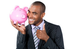 Businessman with piggy bank Stock Photo