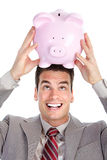 Businessman with a piggy bank Stock Photography