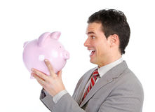 Businessman with a piggy bank Royalty Free Stock Photography